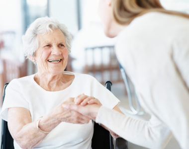 Senior woman being helped by a caregiver