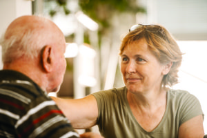 Warm embrace to a loved one in a senior living community